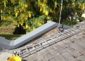GRP encapsulation detail to roof parapet