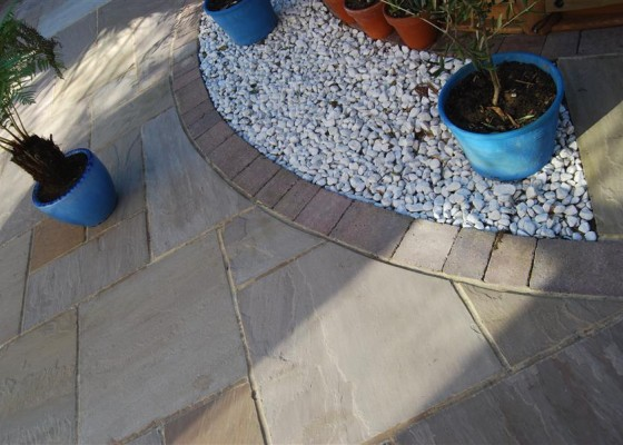 Hand cut stone paving with Tegula edgings