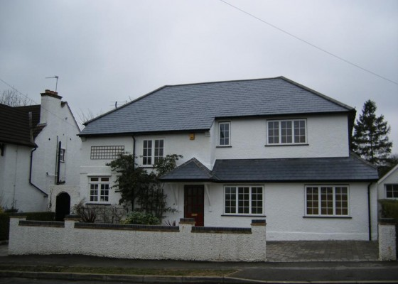 Two storey extension (to right) & new slate roof